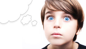 Young boy  with an empty thought bubble. Thoughtful young boy  with an empty thought bubble Royalty Free Stock Images