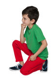 Thoughtful young boy in the green shirt Royalty Free Stock Photo