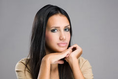 Thoughtful young brunette beauty. Stock Image