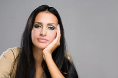 Thoughtful young brunette beauty. Royalty Free Stock Photography