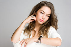 Thoughtful young brunette beauty. Royalty Free Stock Image