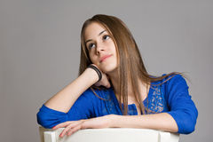 Thoughtful young brunette girl. Stock Photos