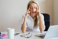 Thoughtful woman concentrating at work. Thoughtful young business woman concentrating at work stock photo