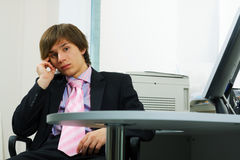 Thoughtful young businessman. Stock Image