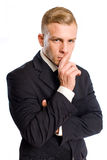 Thoughtful young businessman. Stock Photo