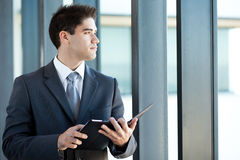 Thoughtful young businessman Stock Image