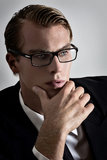 Thoughtful young businessman. Young businessman thougthful with a calm attitude Royalty Free Stock Images