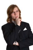 Thoughtful young businessman. Portrait of handsome young businessman with long hair isolated on white background Royalty Free Stock Image