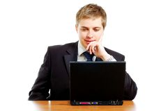 Thoughtful young businessman behind the computer Stock Images