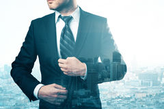Career concept. Thoughtful young businessman on creative city background with copy space. Career concept. Double exposure Royalty Free Stock Image