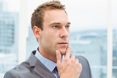 Thoughtful young businessman looking away Royalty Free Stock Image
