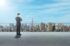 Young businessman on rooftop stock photo