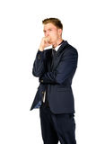 Thoughtful young businessman  on white. Background Royalty Free Stock Photo