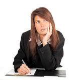 Thoughtful young businesswoman with clipboard Royalty Free Stock Images