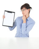 Thoughtful young businesswoman with clipboard Stock Photos