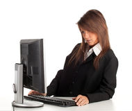 Thoughtful young businesswoman with computer Stock Photo