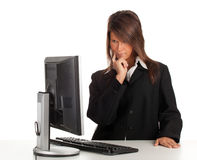 Thoughtful young businesswoman with computer Stock Images