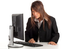 Thoughtful young businesswoman with computer Royalty Free Stock Image