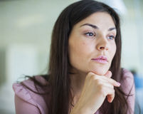Thoughtful young businesswoman looking away in office Royalty Free Stock Photo