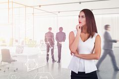 Thoughtful woman in office, business interface royalty free stock image
