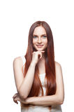 Thoughtful young  casual female. Vertical studio portrait of young attractive green-eyed caucasian female with long natural straight shiny red hair dressed in Royalty Free Stock Photography