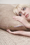 Thoughtful Young Girl In Lying Bed. Closeup of thoughtful young girl in lying bed royalty free stock photography