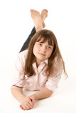 Thoughtful Young Girl Lying On Stomach Royalty Free Stock Photo