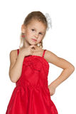 Thoughtful young girl in red dress Royalty Free Stock Photography