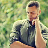 Thoughtful young handsome man   Royalty Free Stock Photography