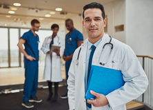 Thoughtful young Hispanic doctor in a hospital Stock Image
