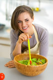 Thoughtful young housewife in kitchen Stock Photography