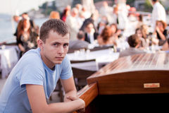Thoughtful young man. Out in a restaurant Royalty Free Stock Photos