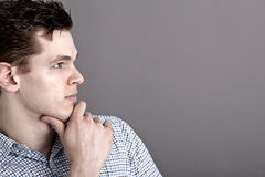 Thoughtful young man Stock Photos