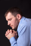 Thoughtful young man in blue shirt Stock Photos