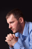 Thoughtful young man in blue shirt Stock Photography