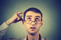 Thoughtful young man in glasses stock images