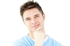 Thoughtful young man looking at the camera Royalty Free Stock Photography