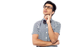 Thoughtful young man looking up Stock Photography