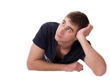 Thoughtful young man lying. On isolated white royalty free stock photo