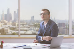 Thoughtful young man in office Royalty Free Stock Photos