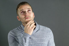 Thoughtful young man Stock Images