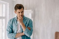 Free Thoughtful Young Man Wearing Lounge Wear Clothes Royalty Free Stock Photo - 127720885