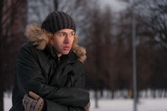 Thoughtful young man in the winter Park Royalty Free Stock Image