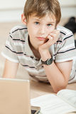Thoughtful young teenage schoolboy Stock Image