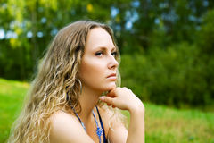 Sad beautiful woman with long curly hairs outdoor Stock Photos