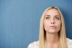 Thoughtful young woman biting her lip Royalty Free Stock Images