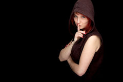 Thoughtful young woman in brown hood Stock Photography