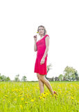 Thoughtful young woman in buttercup field Stock Images
