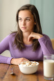 Thoughtful young woman with cereal breakfast table Stock Photos