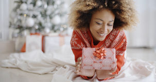 Thoughtful young woman with a Christmas gift Stock Photo